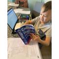 Ollie working hard on his English work