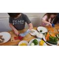 Taylor-James carefully using his kitchen skills