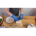Taylor James carefully using his kitchen skills