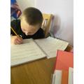 Alfie writing his poem