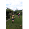 Aaron and his Grandad playing badminton