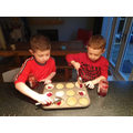 Dylan working with his brother to make jam tarts for DnT