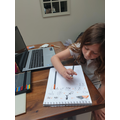 Amelia working hard on her story map