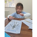 Amelia work hard on her science work