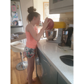 Lillia making cupcakes