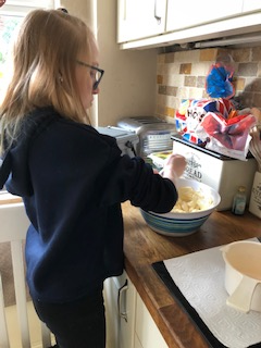 Helping to make a cake.