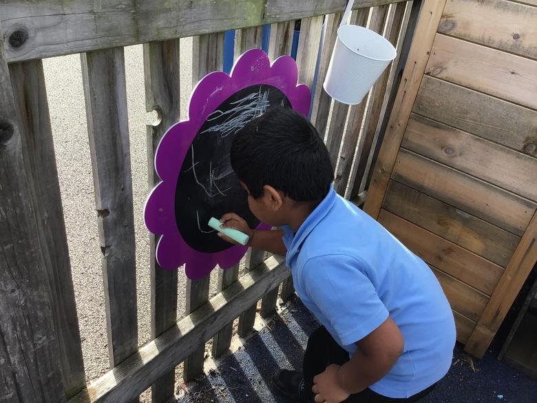 Practising phonics in our outdoor area
