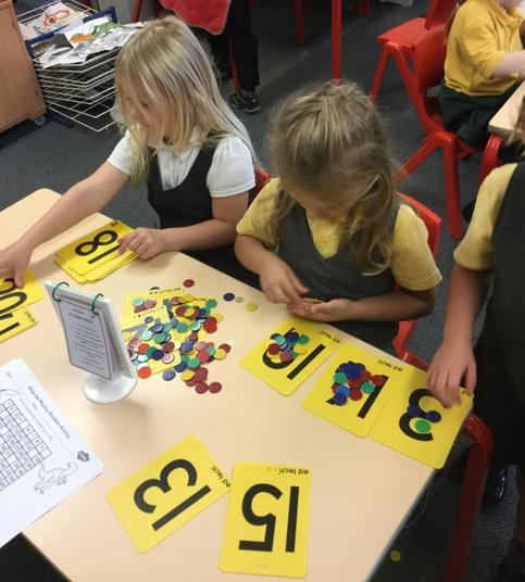 Matching the counters with the number on the card - fabulous!