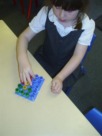 Placing the pegs in the shapes