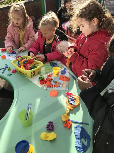 Outdoor fun making playdough shapes