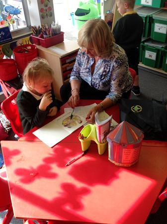 Reading with our helper Mrs Coates