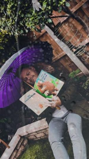 Poor Mr Bell got very wet reading in the garden