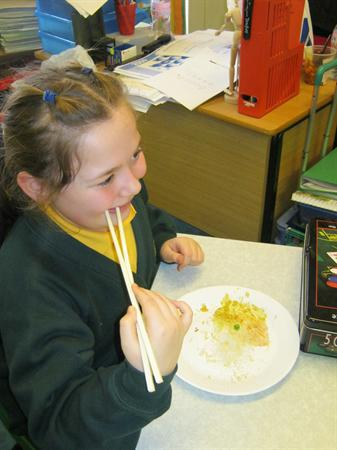 Sophie using chopsticks!