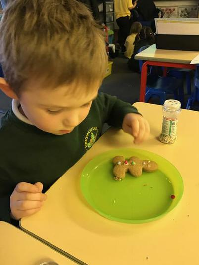 We carefully decorated our gingerbread men.