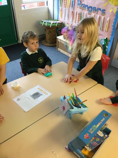 Working as a team to make our Diwali tealights!