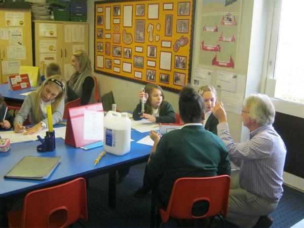 Sharing and explaining learning.