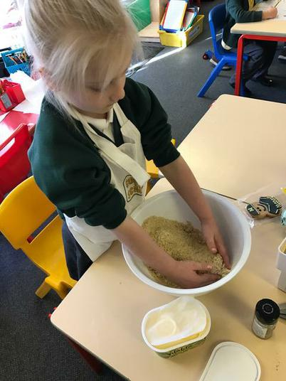 Mixing the ingredients into a crumb mixture.