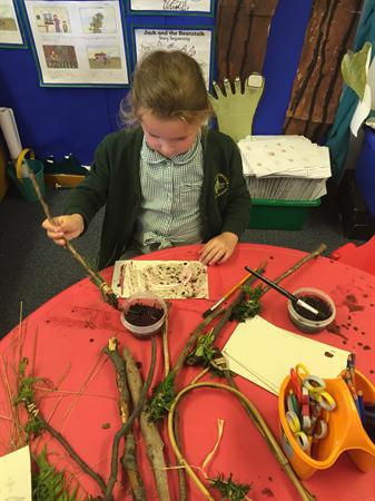 Making mud paint with natural paintbrushes