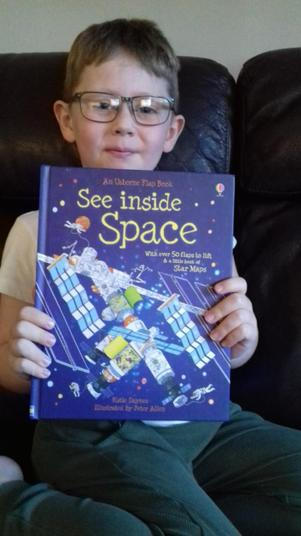 This book is called see inside space and it is a great non-fiction book!