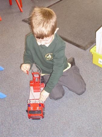 Playing with the fire engine.