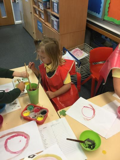 Mixing paints to get the right colour - well done!