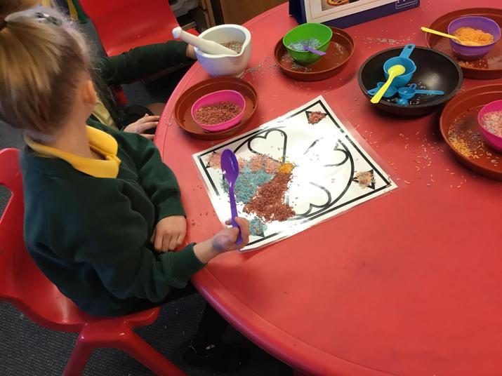 We made rangoli patterns with rice.