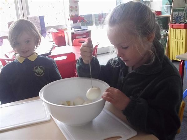 Mixing the egg and cress