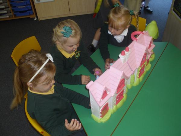 Sharing our dolls house.