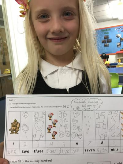 We had to practise writing the number word.