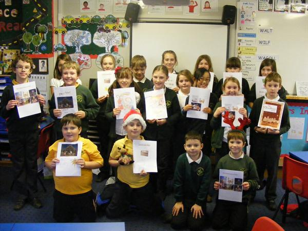 The children show off their Christmas story books