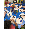 We are painting pictures for Mothers day