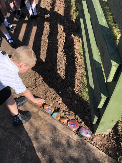 Placing our prayer pebbles