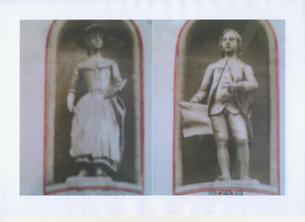 St Luke's boy and girl statues