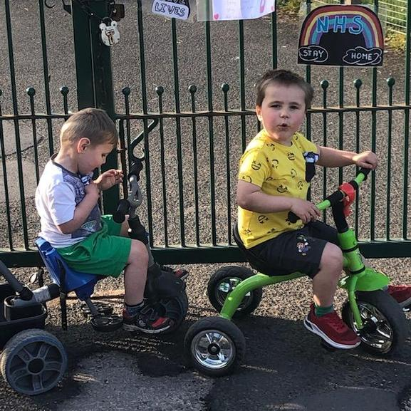 Jack and Kian enjoying a bike ride outside school
