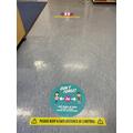 The 2m markings on the floor around school.