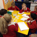 A maths group working hard on reasoning.