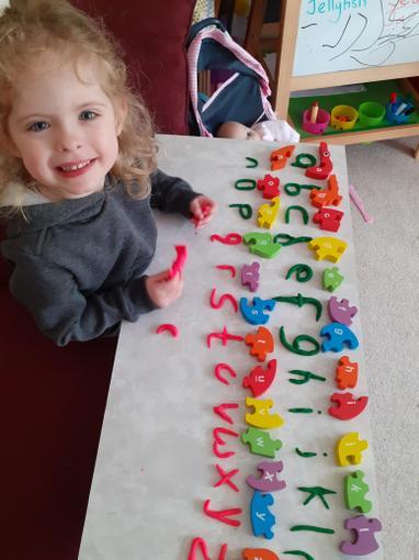 Chloe made a play dough alphabet