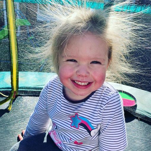 Isla having fun on her trampoline