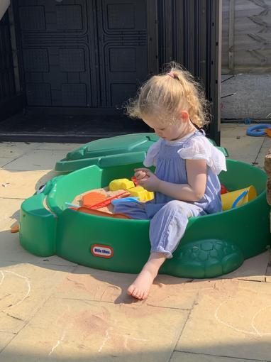Felicity enjoying her sand pit
