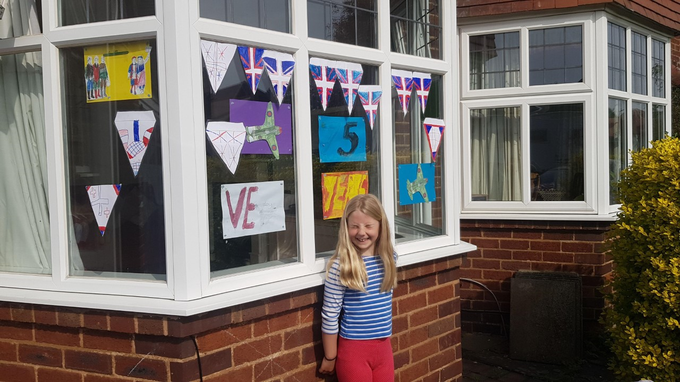 Decorating the house for VE Day.