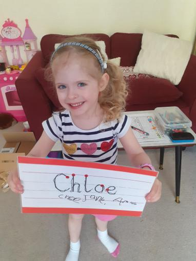 Chloe writing all three names now!