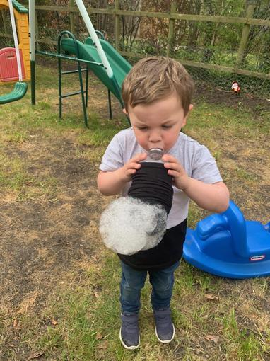 Jensen blowing bubbles