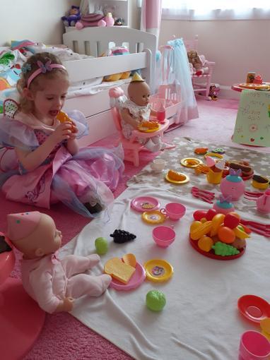 Chloe enjoying a dolly's tea party!