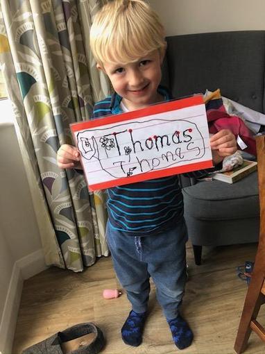 Thomas practising his name writing