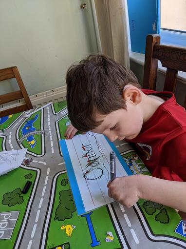Connor practising his name writing