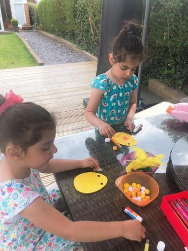 Iyla and Amelia making chicks to celebrate Easter