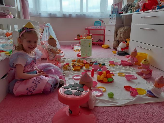 Chloe having fun at dolly's tea party
