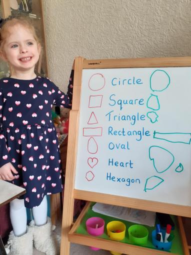 Chloe learning about 2D shape names