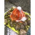Erupting volcano by Noah