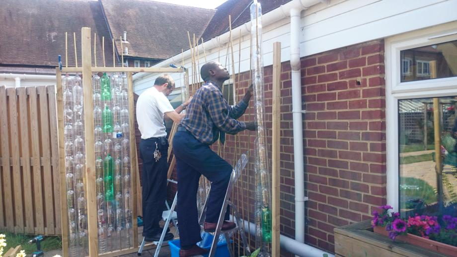 Helping to build our bottle greenhouse